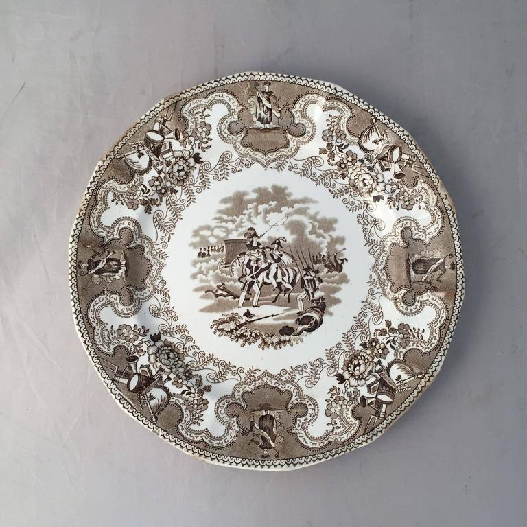 A fine English china plate with the sought-after 'Texian Campaigne' pattern in brown and white transfer ware by Thomas Walker, circa 1845-1851.