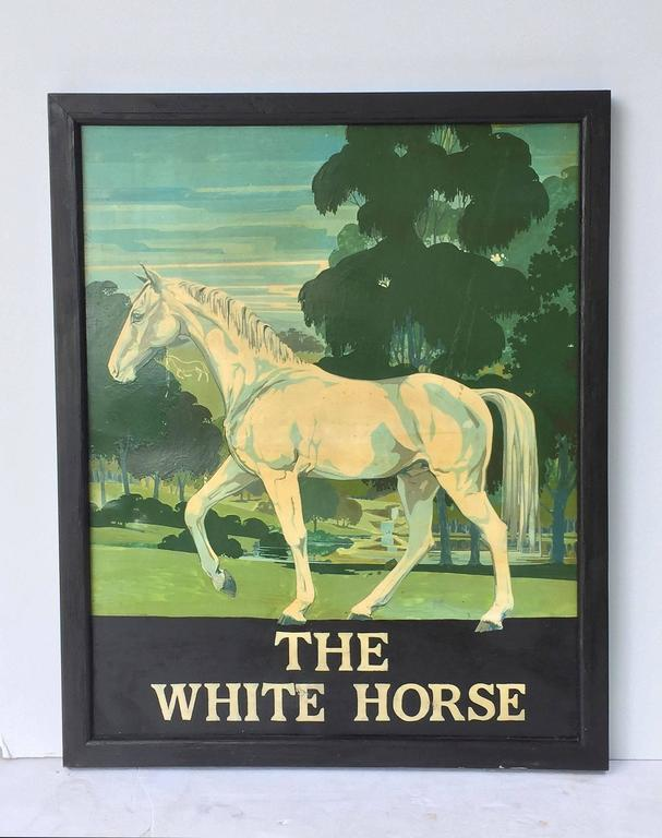 An authentic English pub sign (one-sided) featuring a painting of a white horse, with trees in the background, entitled: The White Horse  A very fine example of vintage advertising artwork, ready for display.