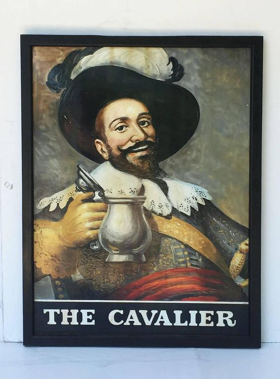 An authentic English pub sign (one-sided) featuring a painting of a smiling man in full 17th century dress holding up an open pewter ale tankard, entitled: The Cavalier  Cavalier was first used as a term for the wealthier Royalist supporters of King