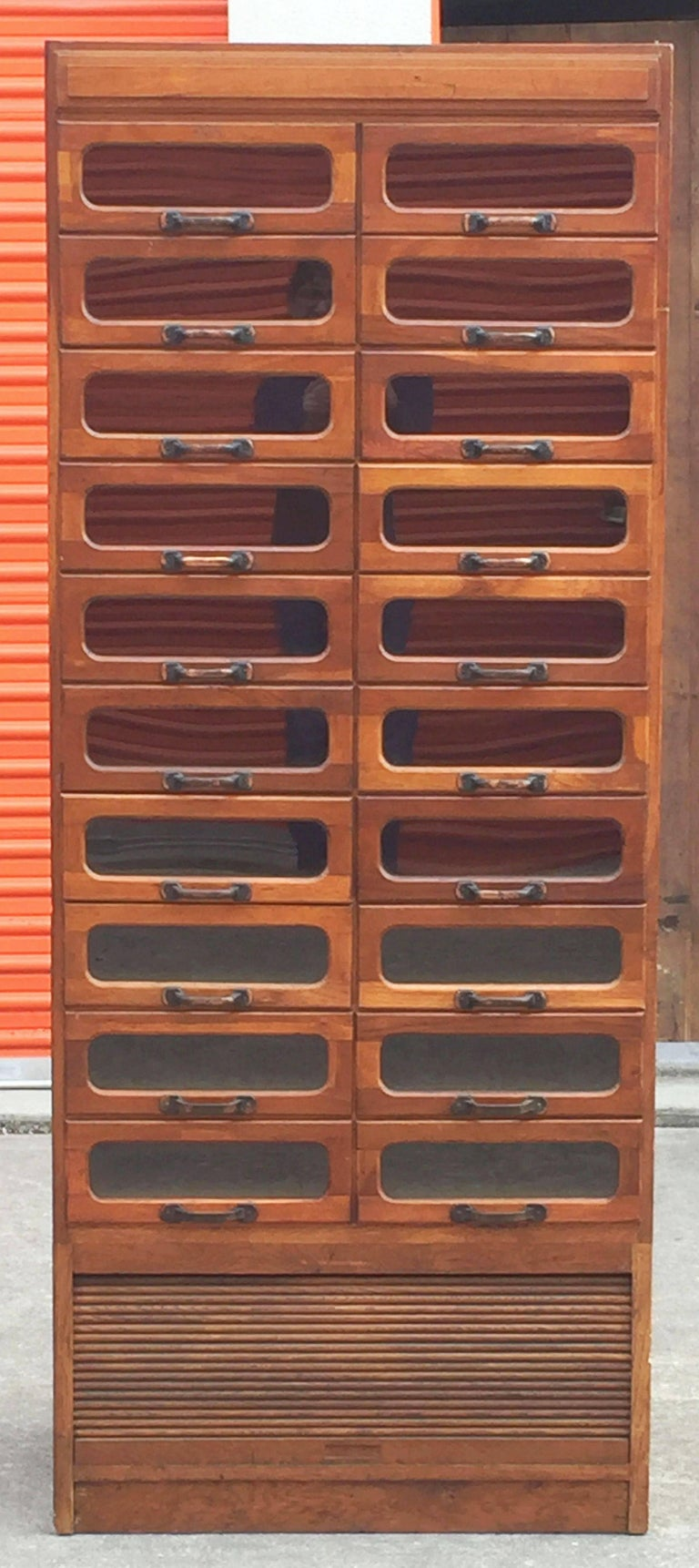 An exceptional large haberdashery or haberdasher's cabinet from England featuring: