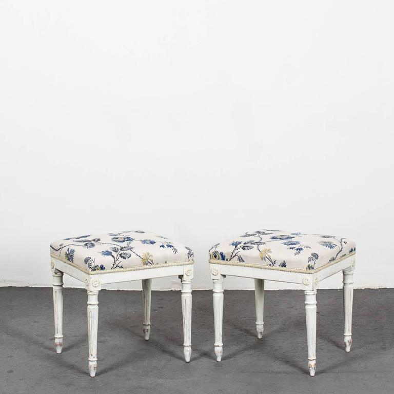 A pair of Swedish Gustavian white painted stools
