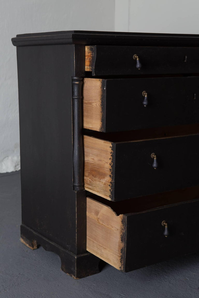 A Swedish chest of drawers made during the 19th century in Sweden. Four drawers with new hardware in brass and blackened wood. Painted in our