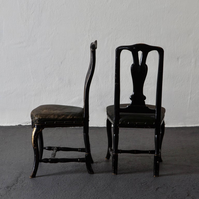 Chairs pair of chinoiserie 18th century, Sweden. A pair of side chairs made during the 18th century in Sweden. Upholstered in black waxed linen, decorated with star-shaped nailheads. Later paint lacquered black paint with gilded decor paint.