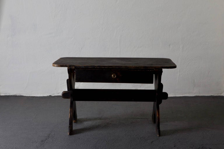 Desk Swedish 19th century black Rustic Sweden. A desk made during the 19th century in Sweden. Painted in our Laserow black. Brass hardware.Height from floor to drawer 22 inches.
