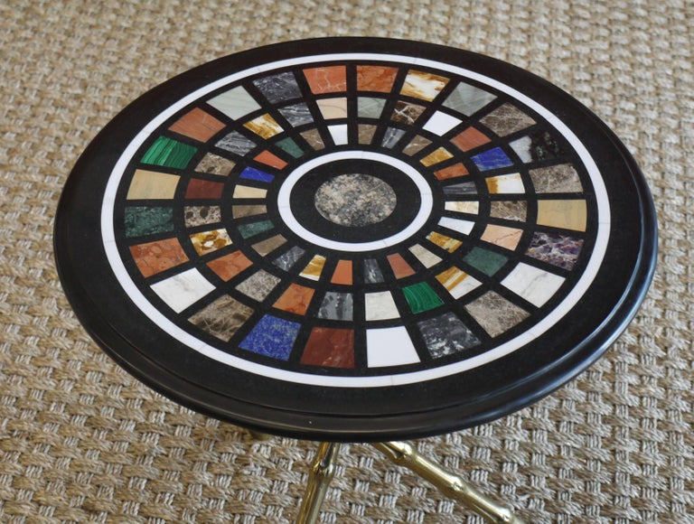 Spectacular 1950s bronze faux bamboo tripod table with a pietra dura specimen marble top featuring various semi precious stones, lapis, onyx, malachite, amethyst and various others.