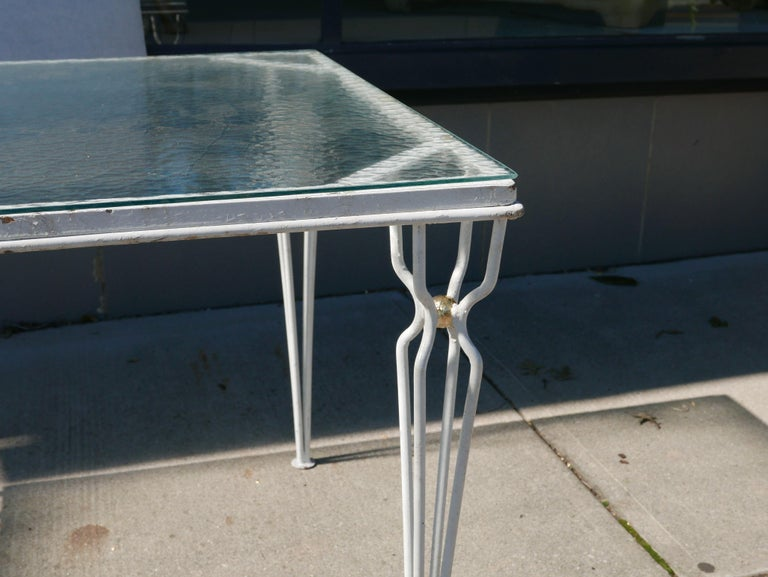 Stunning 1950s Jean Royere style table. Great style with vintage hammered glass textured top that is tempered.