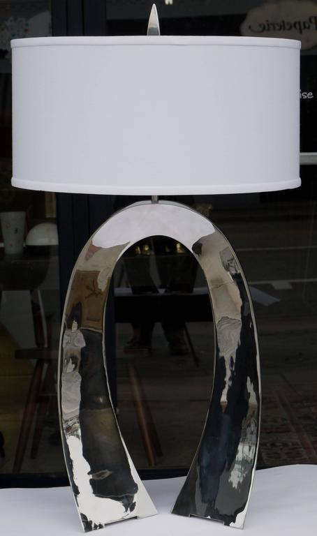 Stunning hand-forged stainless steel lamp by Curtis Norton. Wonderful triangulated tapering arch construction which surface acts like a mirror. Measurement is to top of socket.