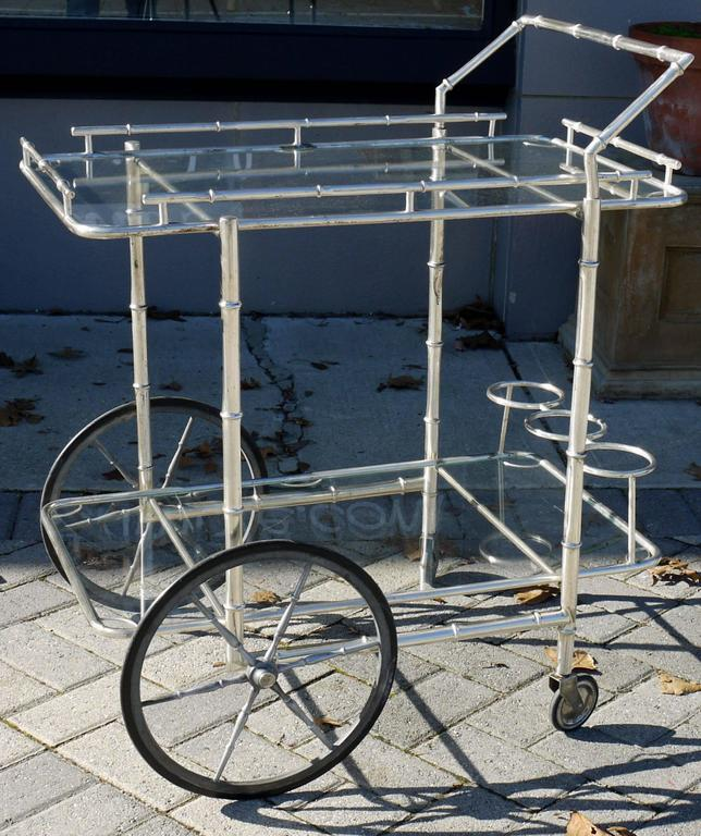 Stunning faux bamboo bar cart made out of brass then silver plated, made in Italy in the 1950s. Great lines, incredible details and construction techniques.