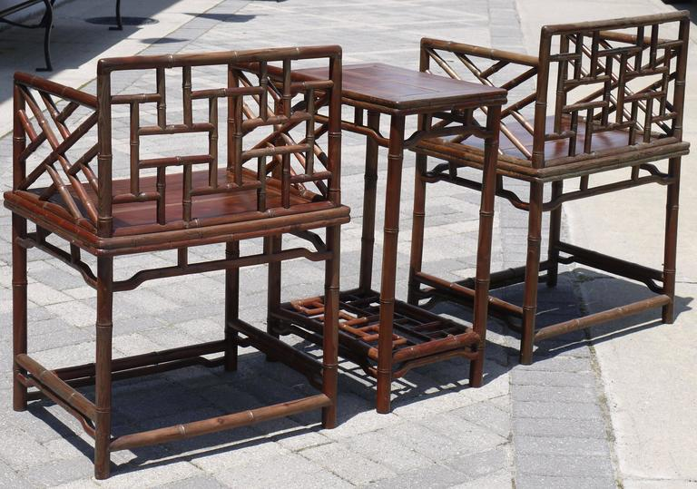 Chinese Chippendale Pair of Chinese Faux Bamboo Chairs and Table Made from Rare Zhazhen Wood For Sale