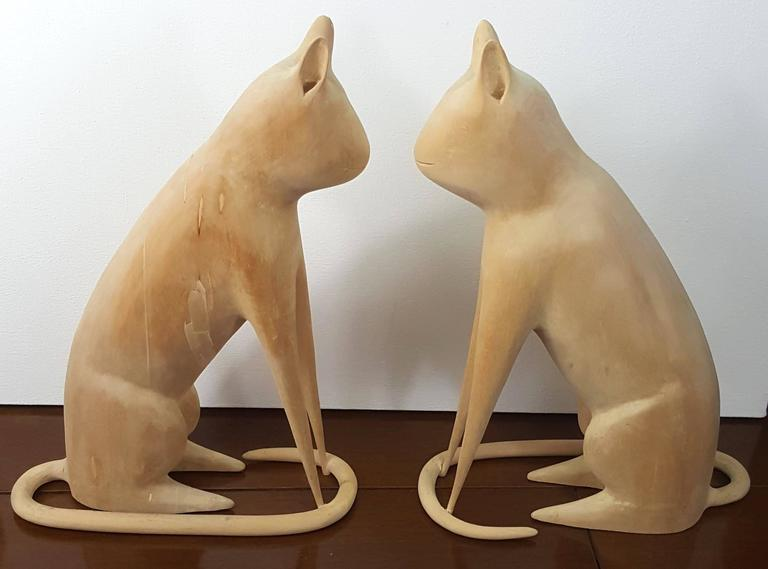 Linvel Barker was a retired metalworker turned folk artist. He didn't start carving until 1984 and he would rough out the shapes on a band saw and his wife would help him finish these. These particular cats were done in 1996 and a very similar cat