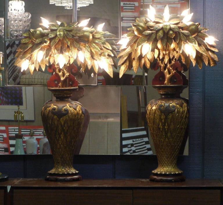 Wonderful pair of whimsical Tony Duquette style lamps made from antique Chinese parts and pieces put together in the 1920s. These were originally wall-mounted sconces but have been redrilled and wired internally so they can be used as table lamps.