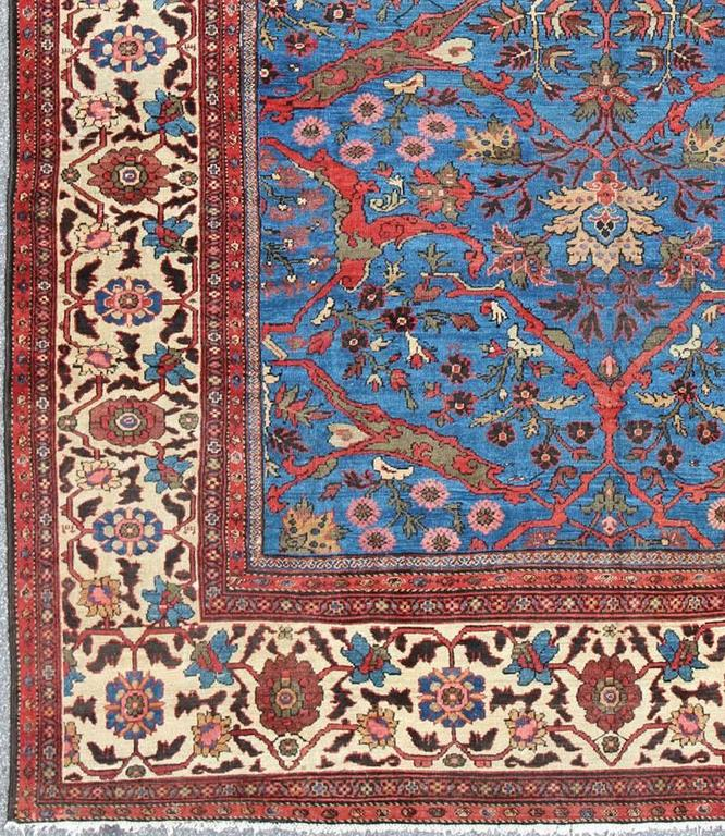 Amazing antique Persian Sultanabad rug in a unique Persian blue background. Rug / N15-0309. This amazingly delightful antique Sultanabad/Ziegler rug from late 19th century Persia features a Classic Persian design with arabesque and vine scrolls that