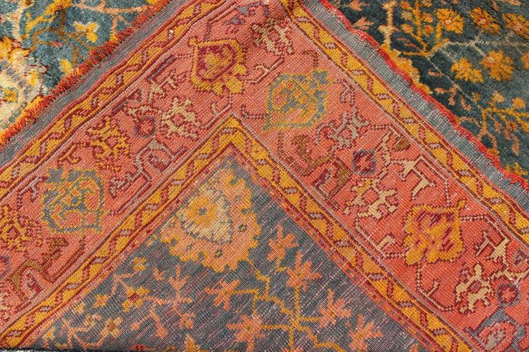 Antique Turkish Oushak Rug With Blue And Salmon Colors At