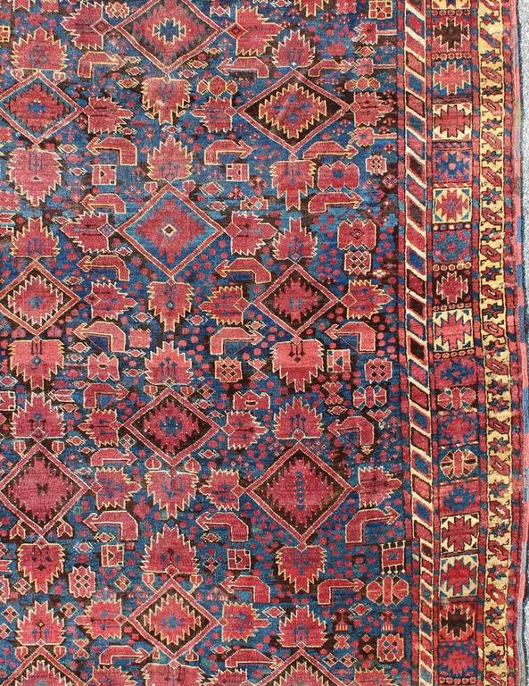 Afghan Beshir Rug With Geometric And Tribal Motifs For