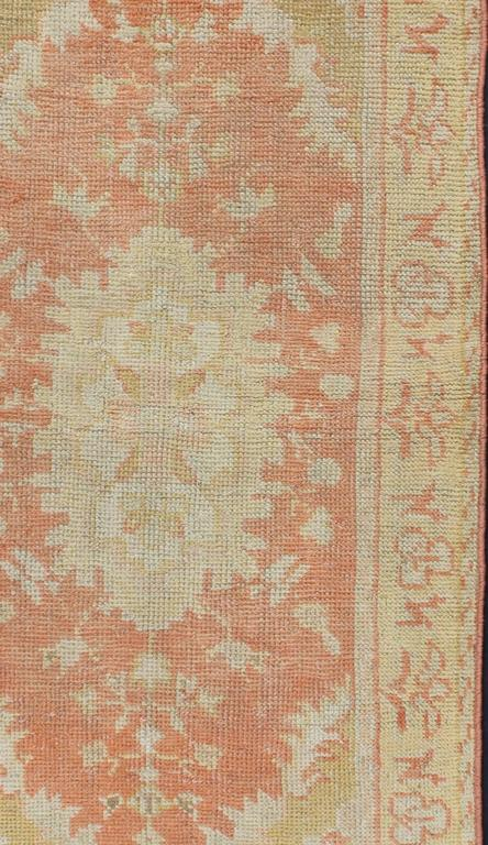 Antique Turkish Oushak Rug With Floral Motifs And Coral