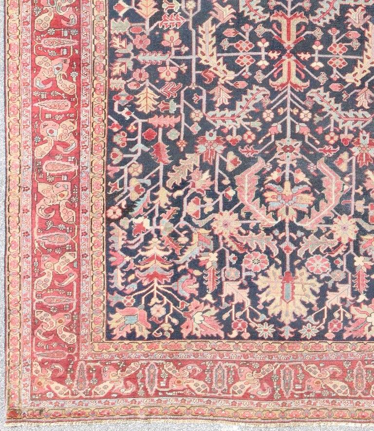 Vintage Persian Heriz Design Wool Area Rug: Navy Background Antique Heriz-Serapi Rug With All-Over