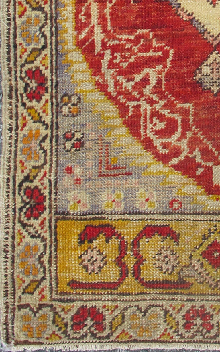 small vintage turkish oushak rug with medallion and flowers in yellow red gray at 1stdibs. Black Bedroom Furniture Sets. Home Design Ideas