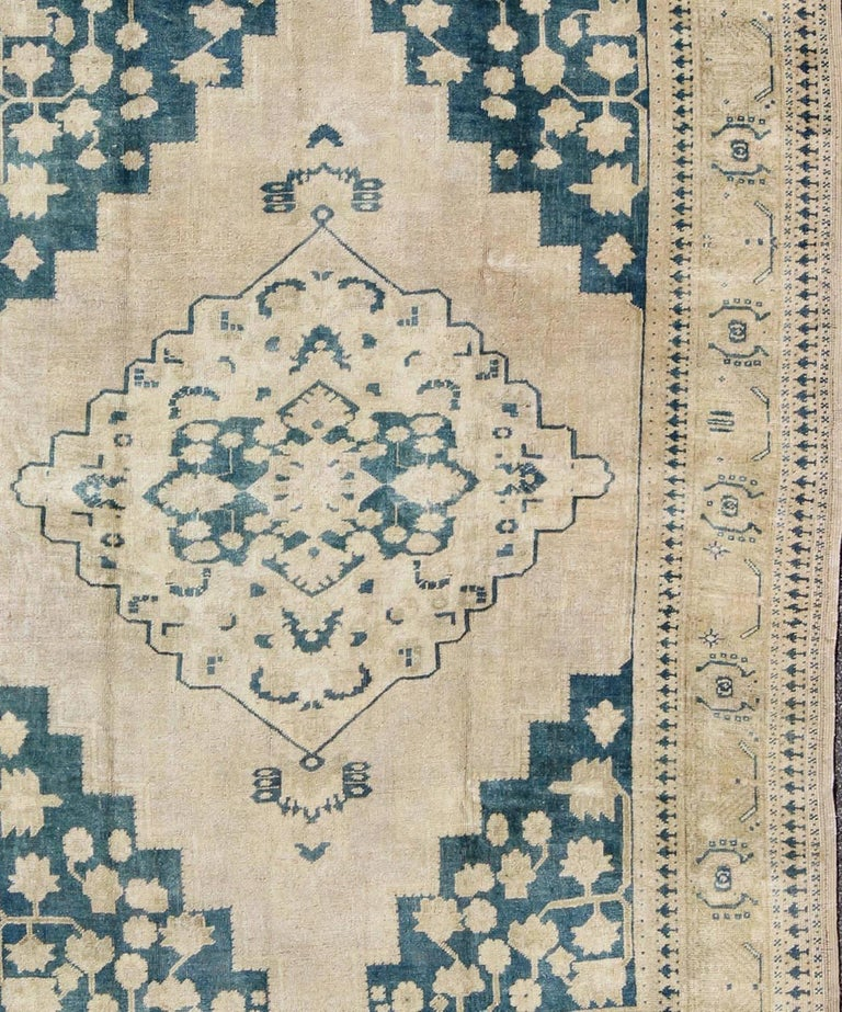 Mid-20th Century Vintage Turkish Oushak Rug in Blue and Cream colors For Sale