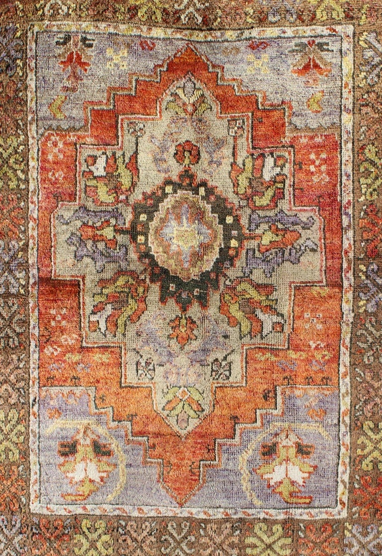 Hand-Knotted Vintage Colorful Turkish Oushak Rug in Orange, Purple, Green and Brown For Sale