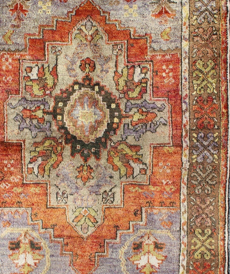 Vintage Colorful Turkish Oushak Rug in Orange, Purple, Green and Brown In Good Condition For Sale In Atlanta, GA