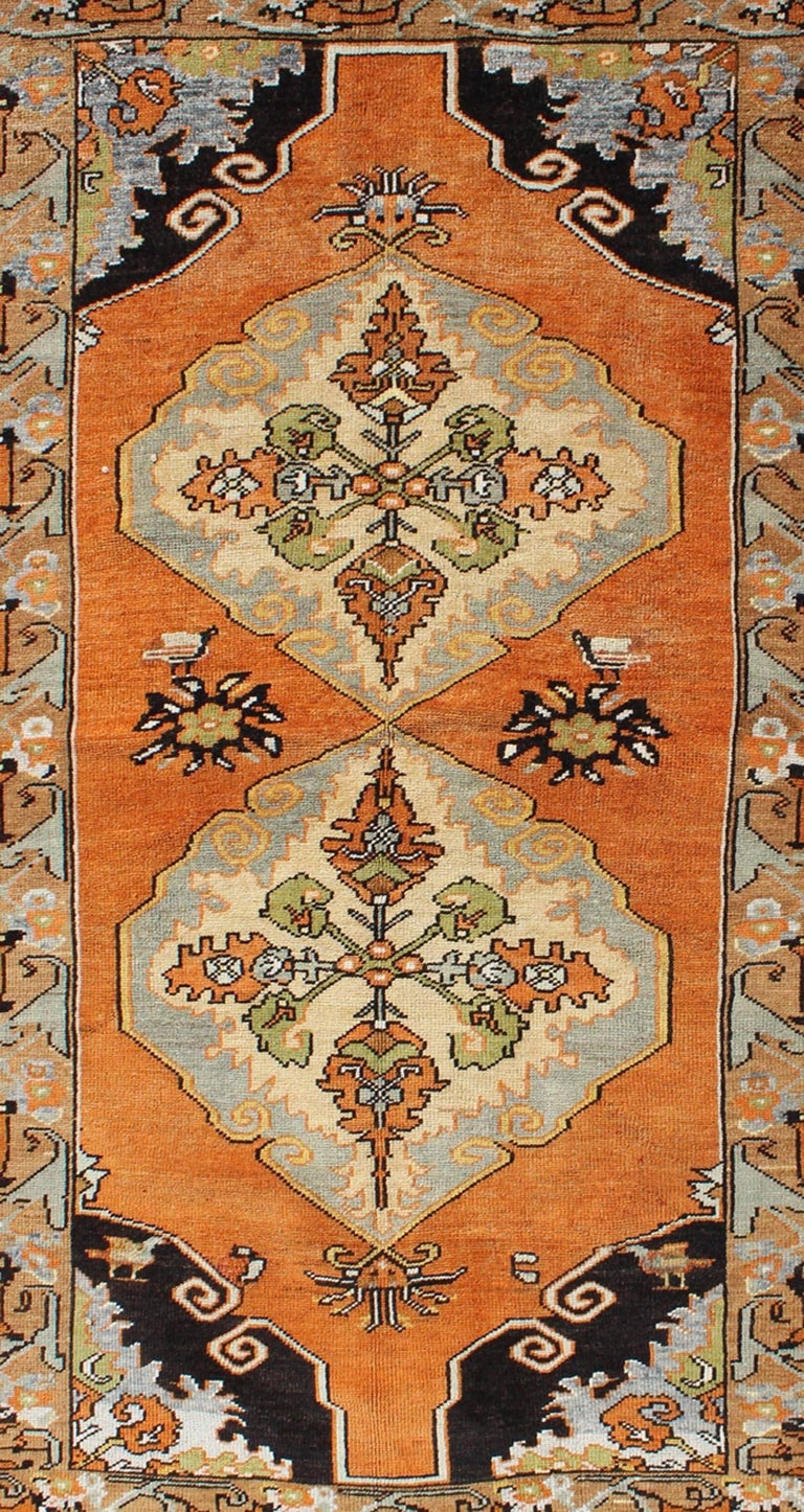 Hand-Knotted Vintage Turkish Oushak with Orange, Light Blue, Gray, Light Green and Brown For Sale