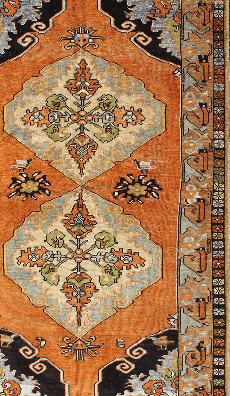 Vintage Turkish Oushak with Orange, Light Blue, Gray, Light Green and Brown In Good Condition For Sale In Atlanta, GA