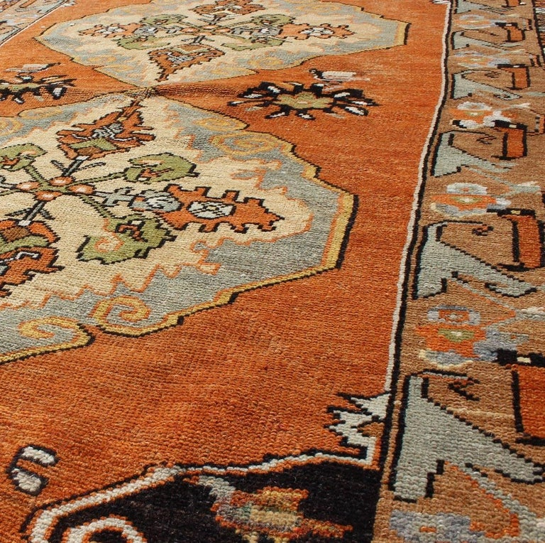 Mid-20th Century Vintage Turkish Oushak with Orange, Light Blue, Gray, Light Green and Brown For Sale