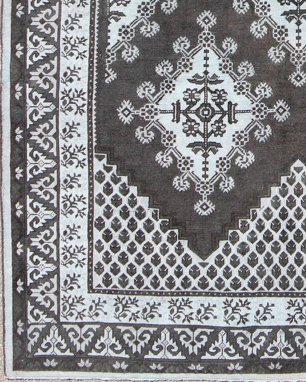 a4452bca5ba This vintage Moroccan carpet features a geometric and tribal design with  black charcoal and blue