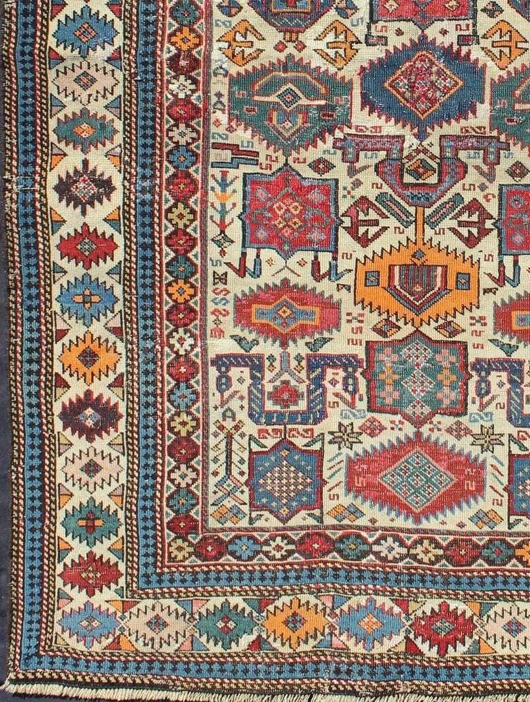"Antique Caucasian rugs from the Shirvan district village of Akstafa are among the rarest types of rugs from that region. Features the classic stylized birds and motifs on a ivory background. Akstafa rugs are more frequently found in either ""long"