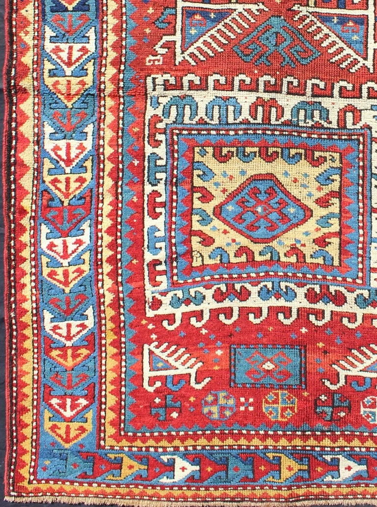 This antique Karabagh rug is of unusually large size and is sufficiently dramatic in both design and color to serve as the main carpet in a room or large foyer. The bold geometry and saturated color make it suitable for a modern interior or a