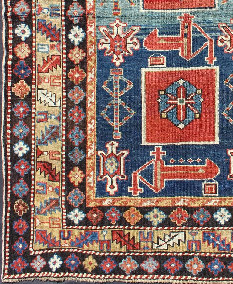 Antique Qaraqashli Caucasian Rug. The archetypal motifs in this piece are accompanied by a tower of stacked polygons with small V-shaped indentations. Each decorative foil is embellished with eight-armed brackets and tiny lozenge-shaped accents.