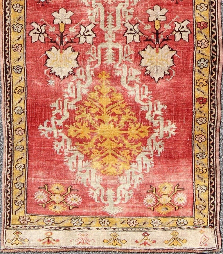 This beautiful antique Turkish Oushak runner from the early 20th Century bears four diamond-shaped medallions with decorative floral motifs. A small border with repeating floral designs surrounds the rug. Measures: 3' x 10.3. List Price: $7,350 Sale