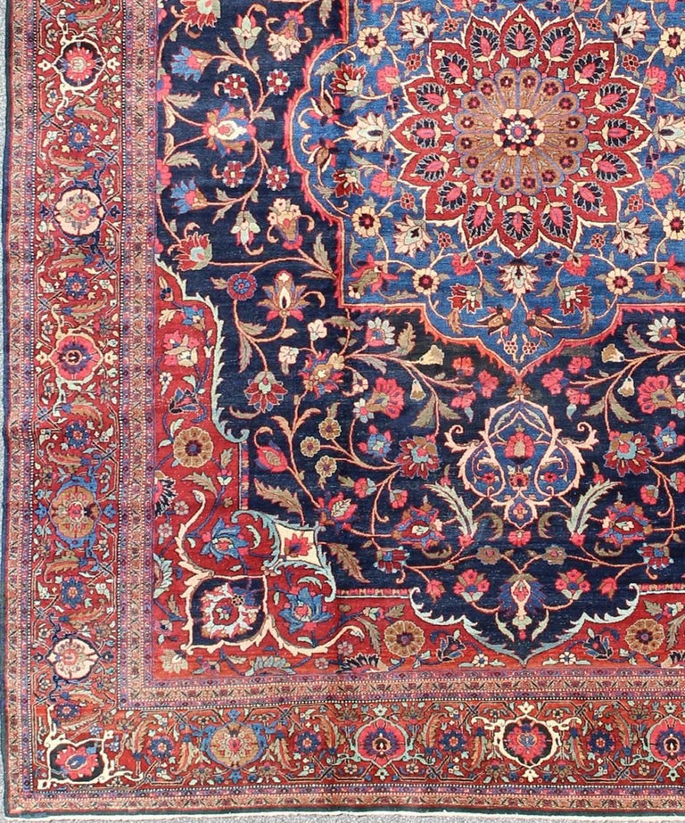 Classic antique Persian Tabriz rug with Central Medallion in blue and red. rug / 10-KE-318. Classic Medallion Tabriz Persian rug.  This spectacular Persian Tabriz bears magnificent splendor indicative of royal tastes, which sought perfection in