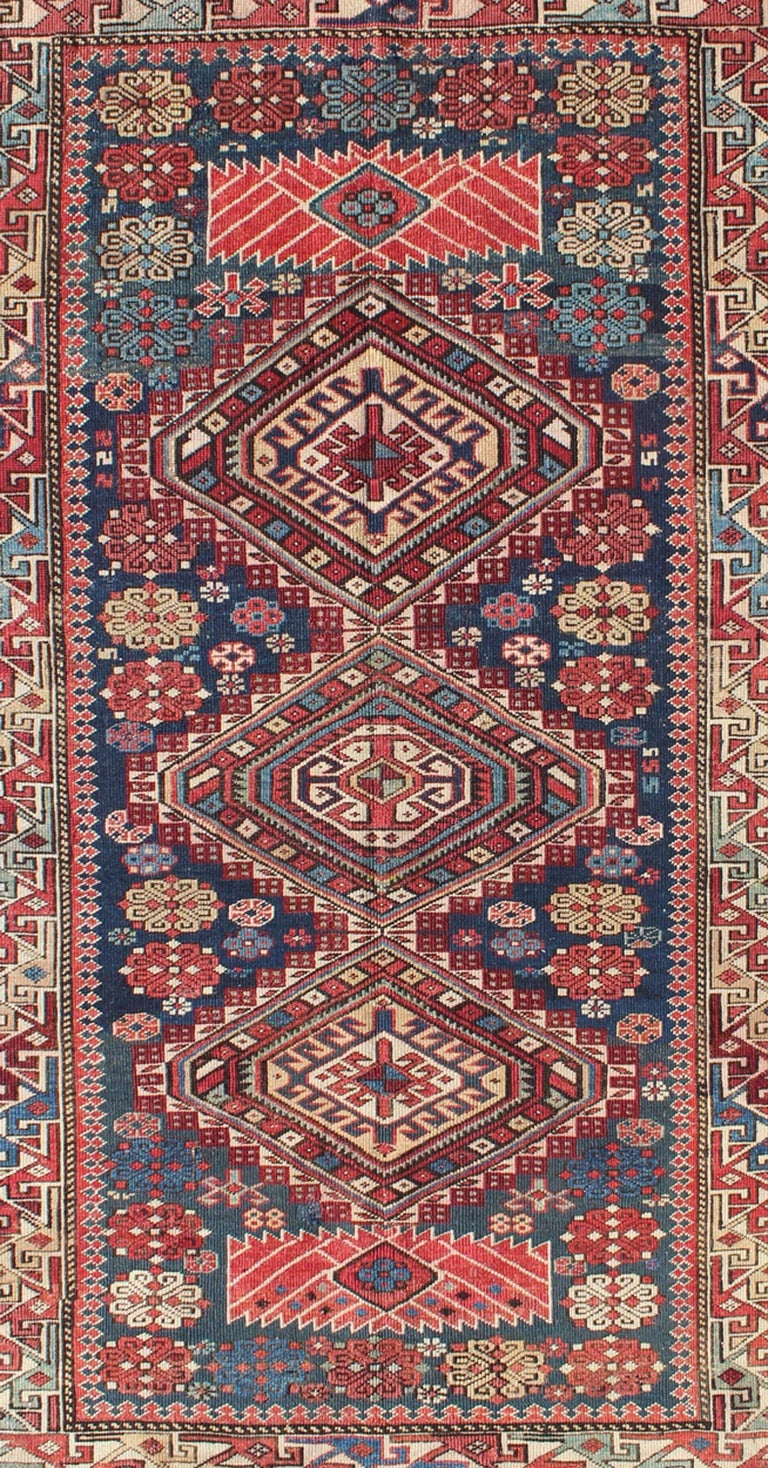 Russian Antique Kazak Rug with Geometric Medallions and Indigo Background For Sale