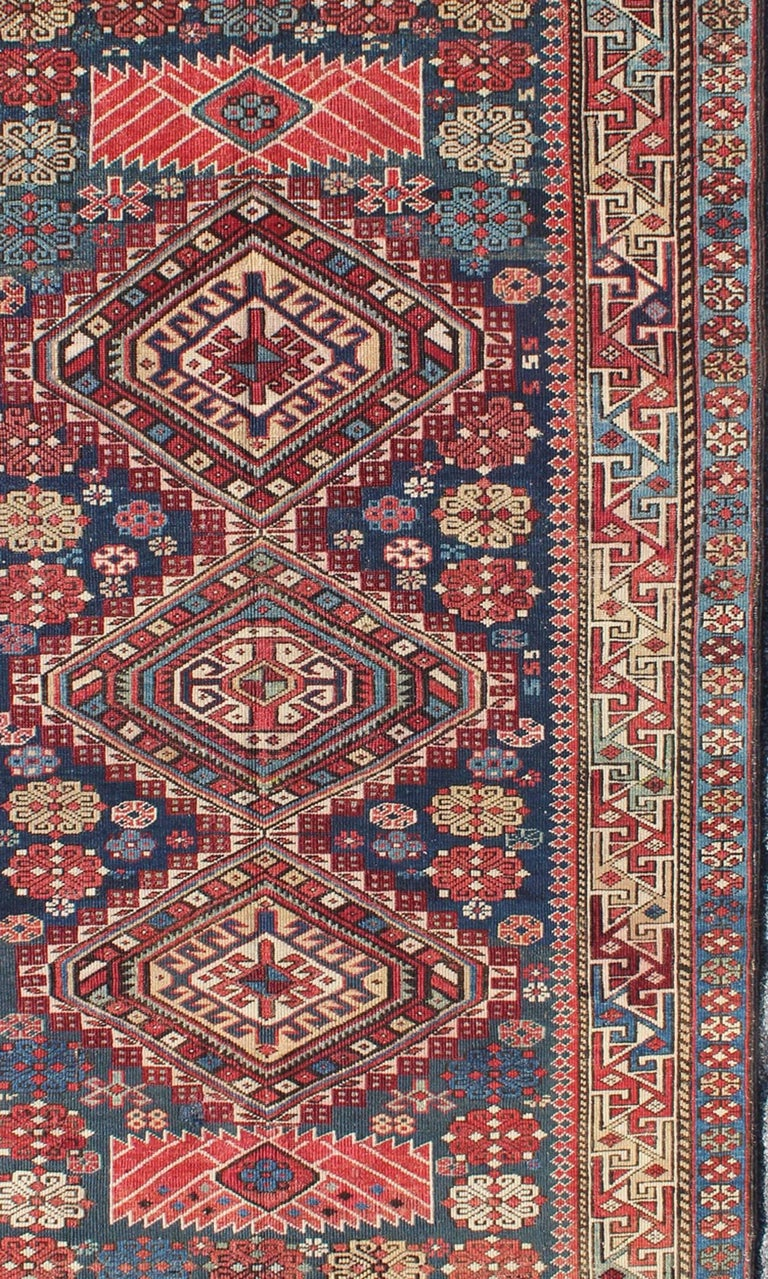 Antique Kazak Rug with Geometric Medallions and Indigo Background In Good Condition For Sale In Atlanta, GA