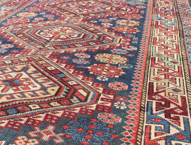 19th Century Antique Kazak Rug with Geometric Medallions and Indigo Background For Sale