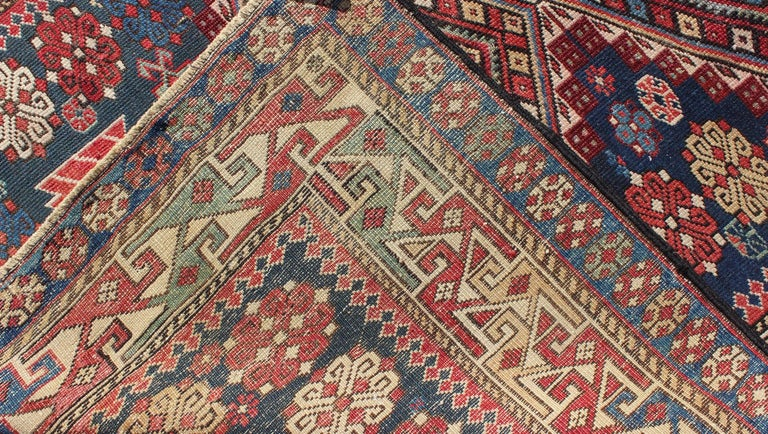 Antique Kazak Rug with Geometric Medallions and Indigo Background For Sale 1