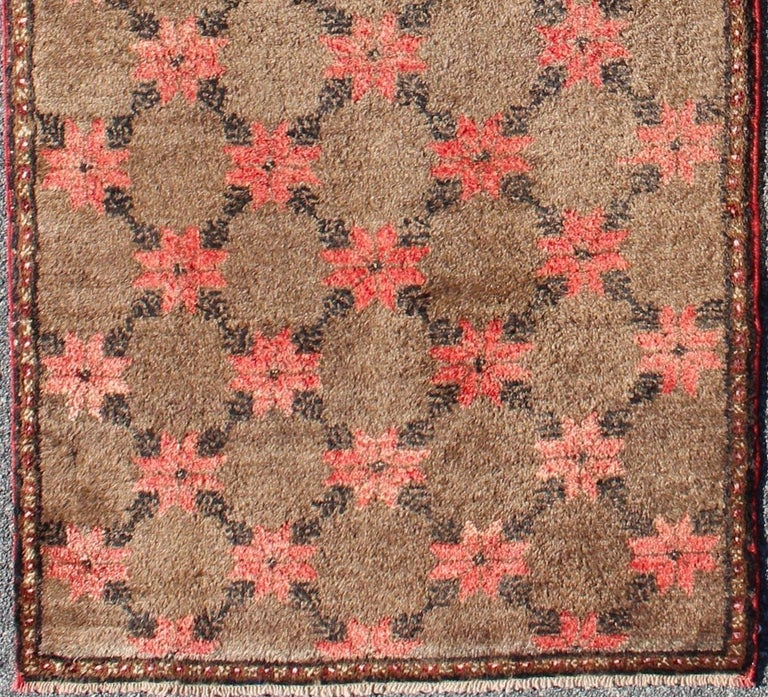 Turkish Tulu runner with Poinsettias design in brown, charcoal, red and ivory, rug en-112936, country of origin / type: Turkey / Tulu, circa mid-20th century  This unique Turkish Tulu runner features an all-over design of vibrant poinsettias,