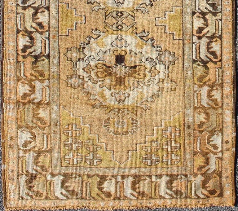 Vintage Turkish Oushak runner with medallions in green, yellow and brown, rug en-419, country of origin / type: Turkey / Oushak, circa mid-20th century  This beautiful antique Oushak runner from mid-20th century Turkey features a Classic Oushak