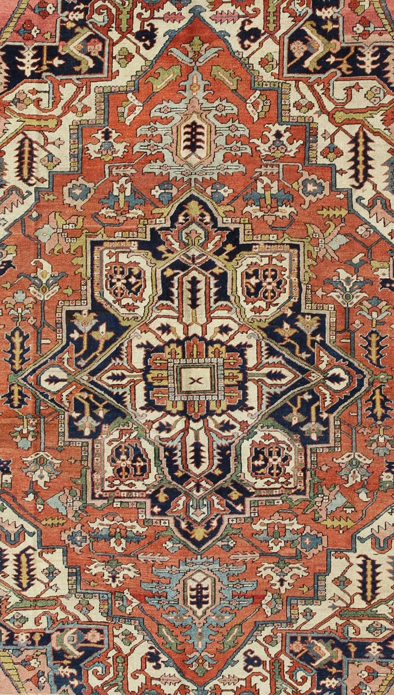 Antique Persian Serapi Rug with Bold Medallion in Orange, Navy Blue and Green In Excellent Condition For Sale In Atlanta, GA