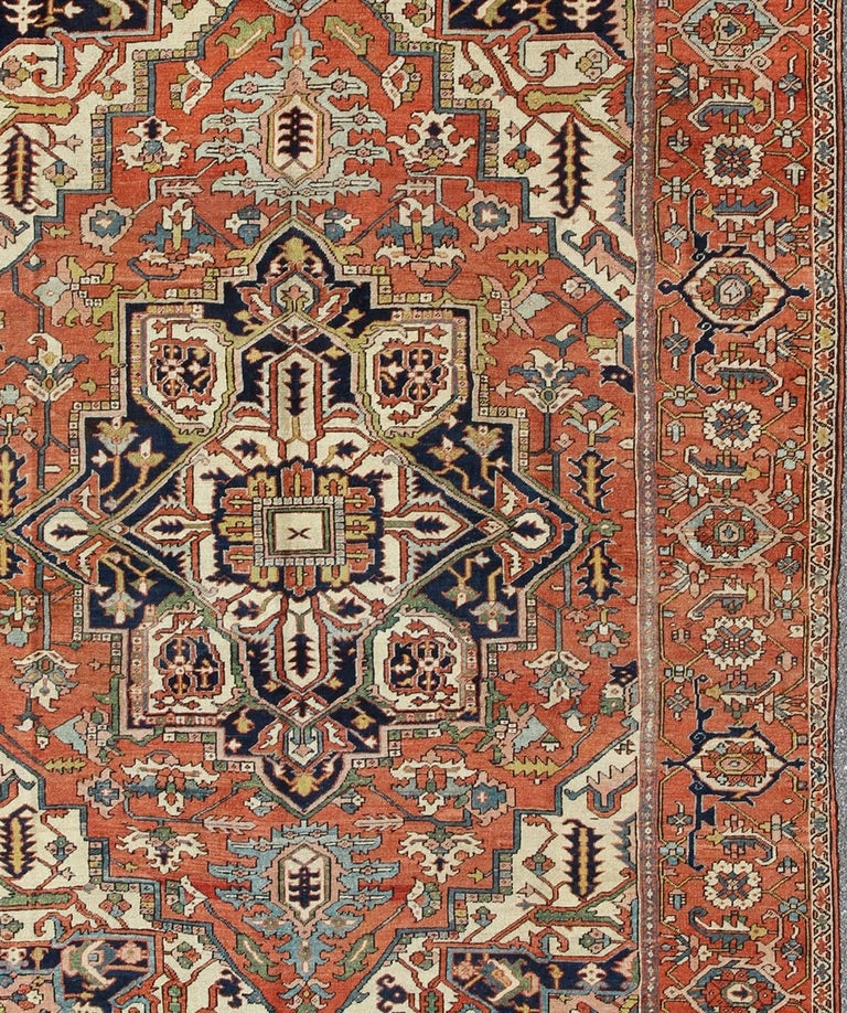 Early 20th Century Antique Persian Serapi Rug with Bold Medallion in Orange, Navy Blue and Green For Sale