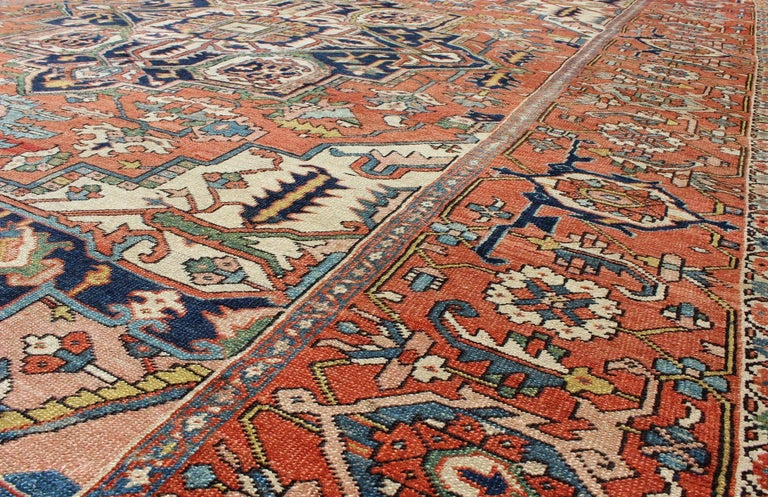 Antique Persian Serapi Rug with Bold Medallion in Orange, Navy Blue and Green For Sale 1