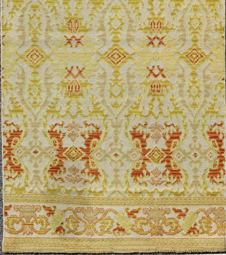 Green, yellow, orange antique Spanish runner rug b-0304-a, country of origin / type: Spain / Spanish, circa 1920  This stunning antique Spanish runner fragment bears a lovely repeating pattern of sub-geometric designs paired with a colorful