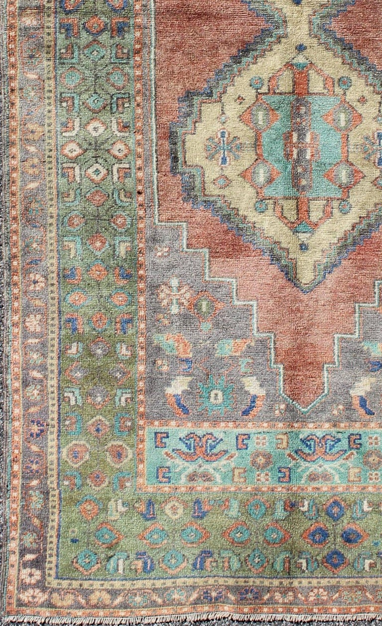 Green and orange Turkish Oushak rug vintage dual diamond medallions, rug tu-en-140417, country of origin / type: Turkey / Oushak, circa 1940  This vintage Turkish Oushak carpet (circa mid-20th century) features a central dual-medallion design, as