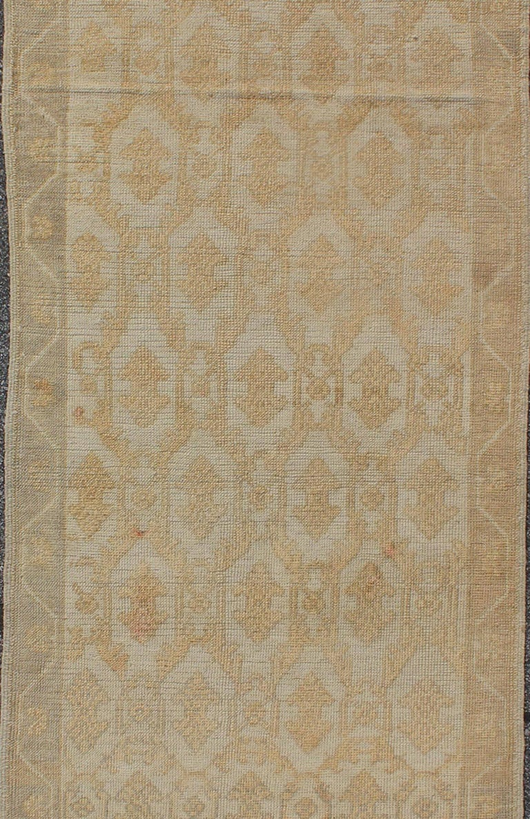 Hand-Knotted Muted Midcentury Turkish Oushak Runner with Latticework Design in Cream For Sale
