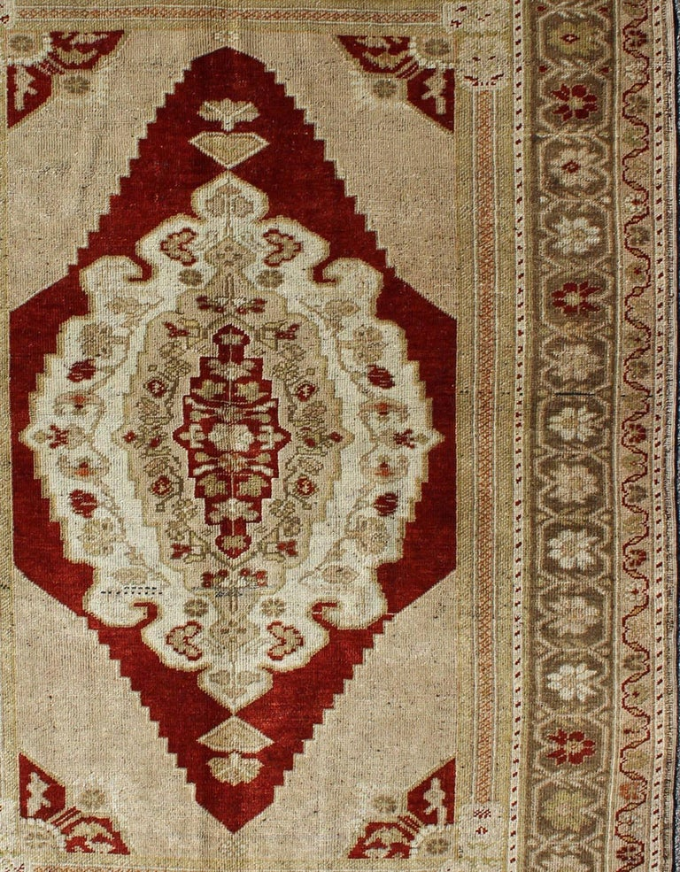 Opulent Layered Medallion Vintage Turkish Oushak Rug in Burgundy, Nude & Gray In Excellent Condition For Sale In Atlanta, GA