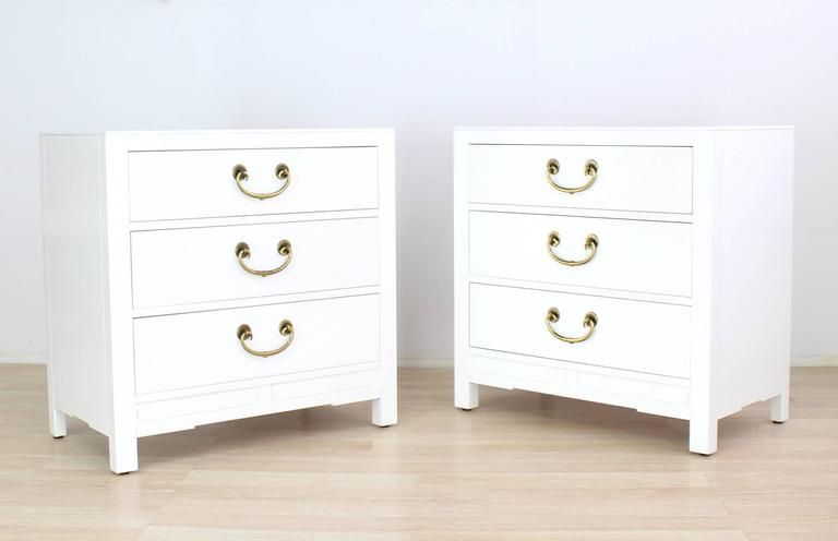 Pair of very nice brass pulls white lacquer three-drawer cabinets.