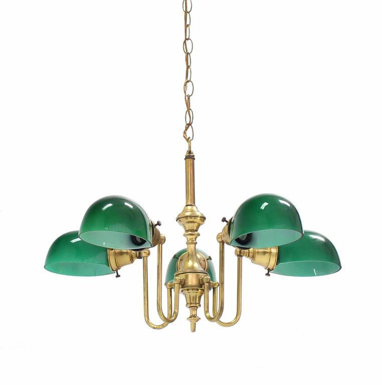 Very nice Mid-Century Modern emerald glass shades brass light fixture.