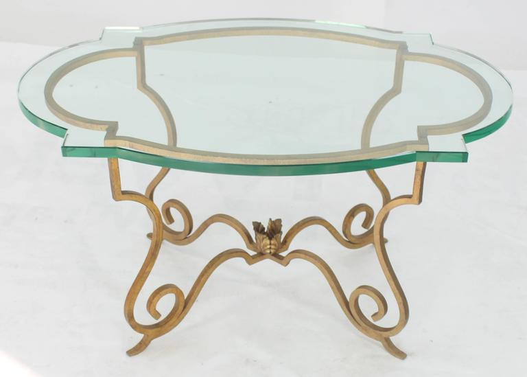 Forged steel base scallop shape glass top side table. Hollywood Regency Mid-Century Modern style. 3/4