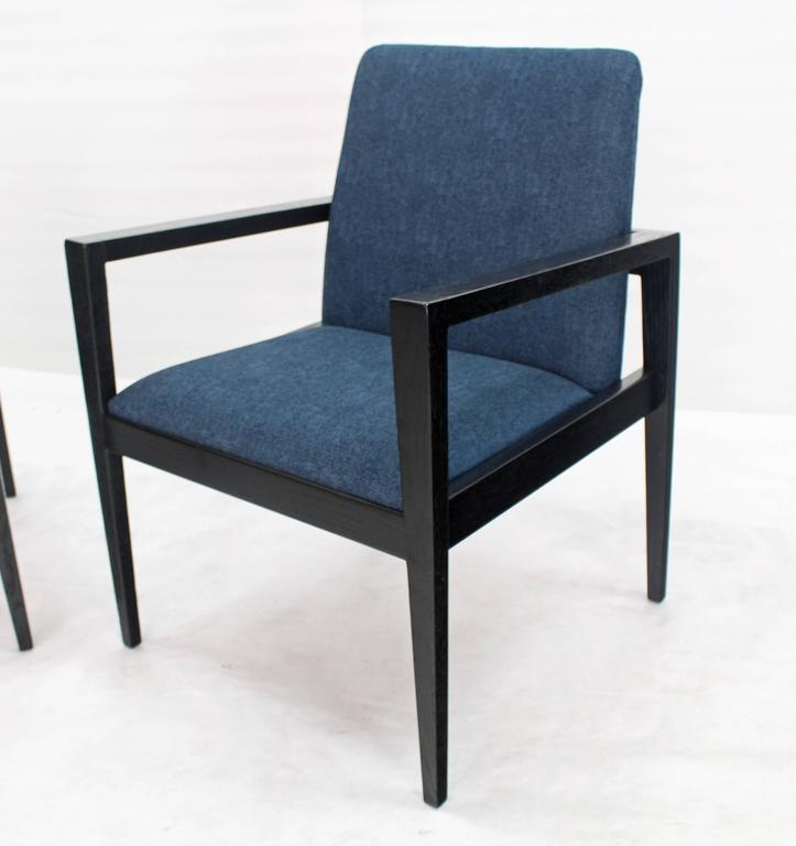 Pair of black lacquer framed new blue upholstery fabric lounge chairs. Nice tapered legs.